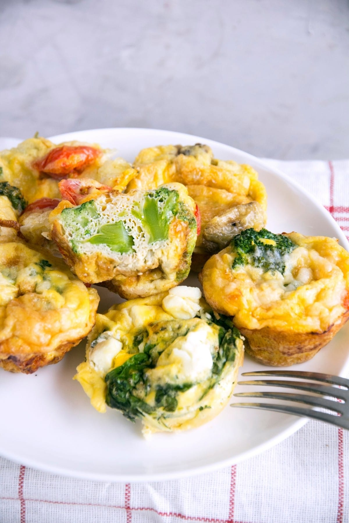A plate full of healthy vegetarian keto egg muffin cups.