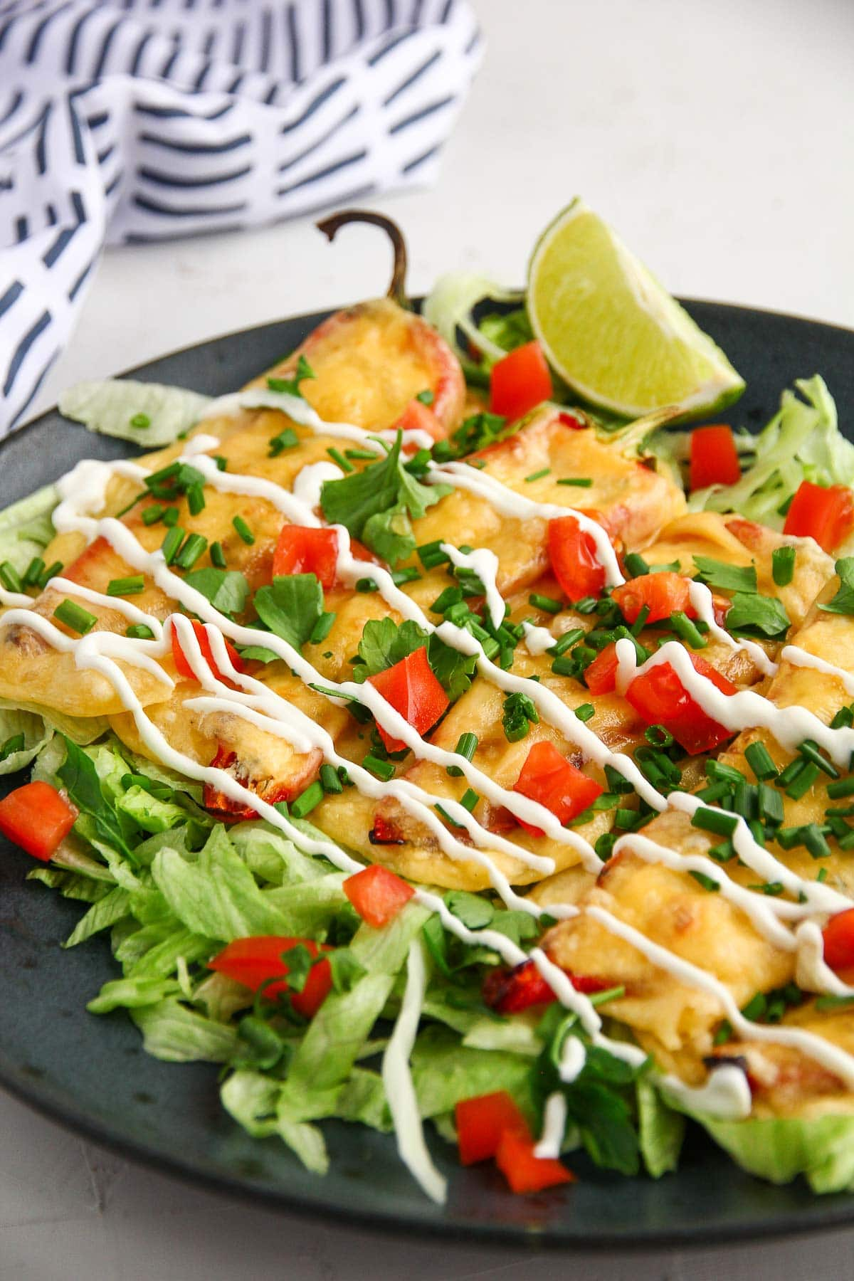 An appetizer recipe for easy red pepper keto taquitos wrapped in cheese.