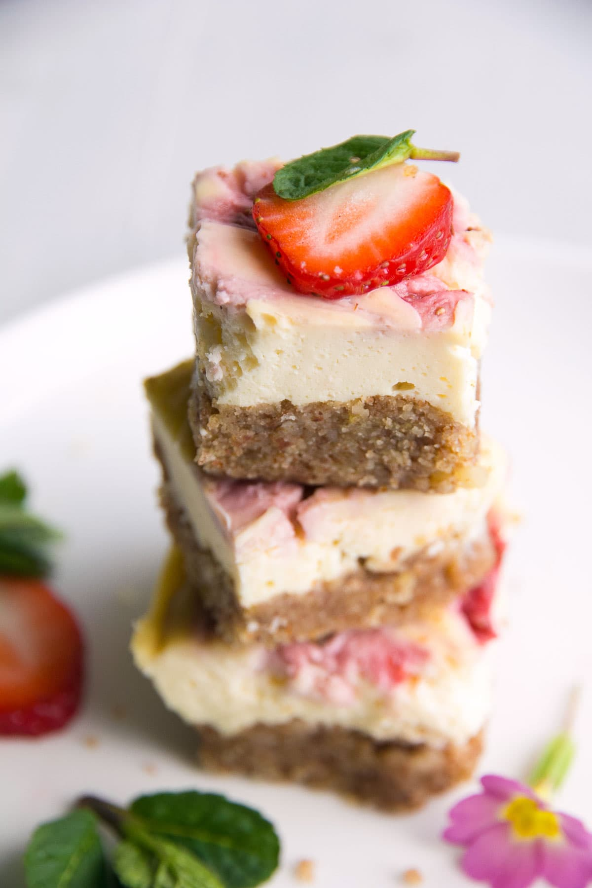 Delicious recipe of strawberry cheesecake bites stacked.