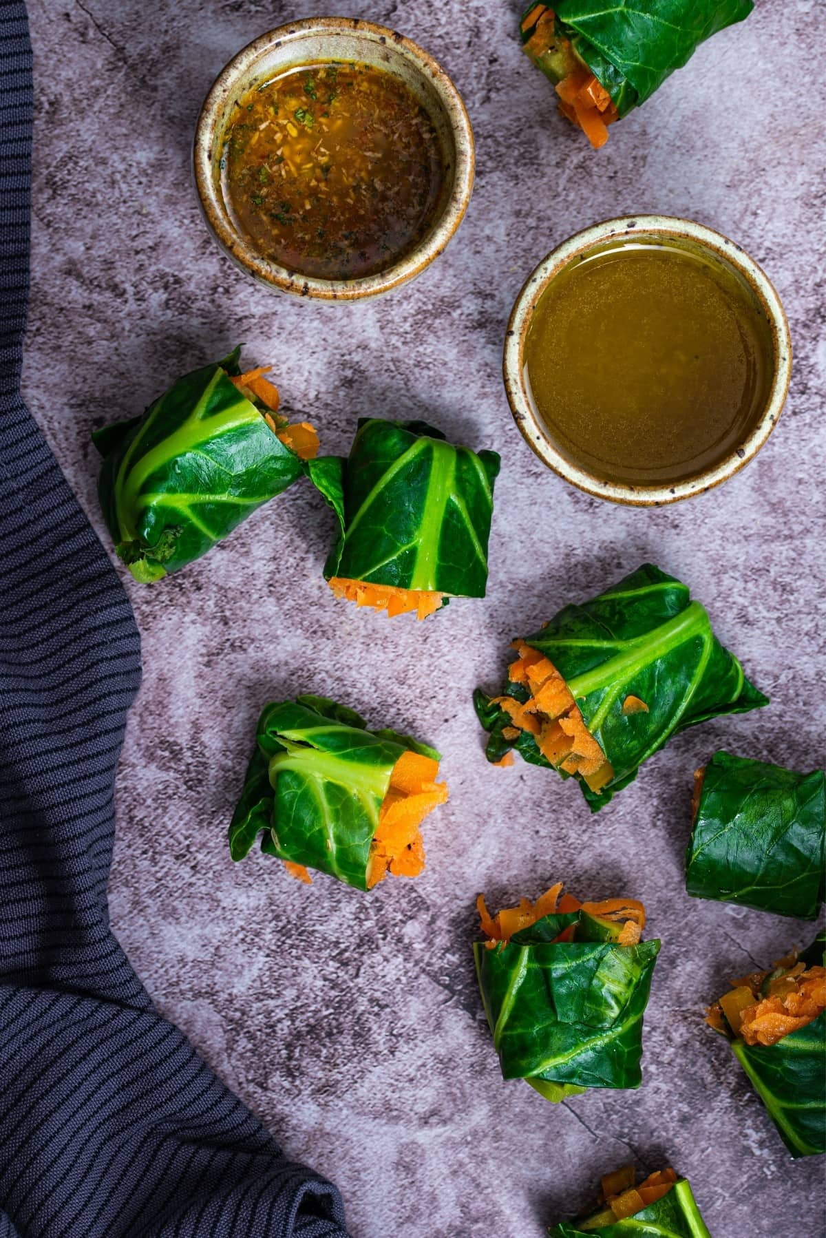 Delicious paleo collard green spring rolls with a dipping sauce.