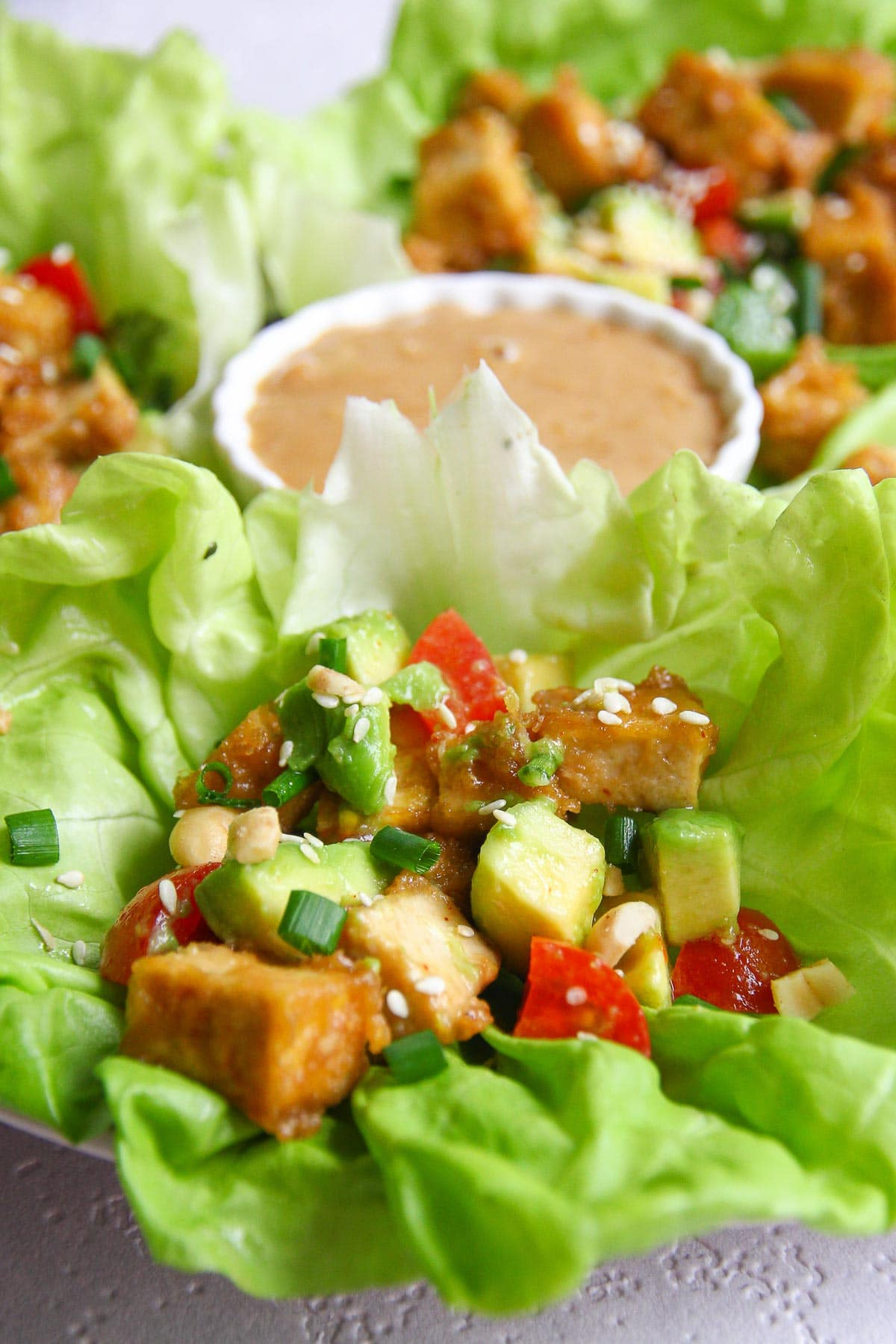 Delicious keto and vegetarian tofu lettuce wraps recipe with a peanut ginger sauce.