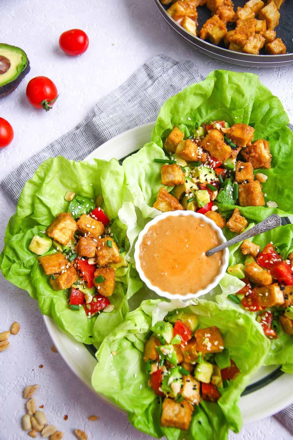 Healthy low carb and vegan tofu lettuce wraps recipe with avocado salsa.
