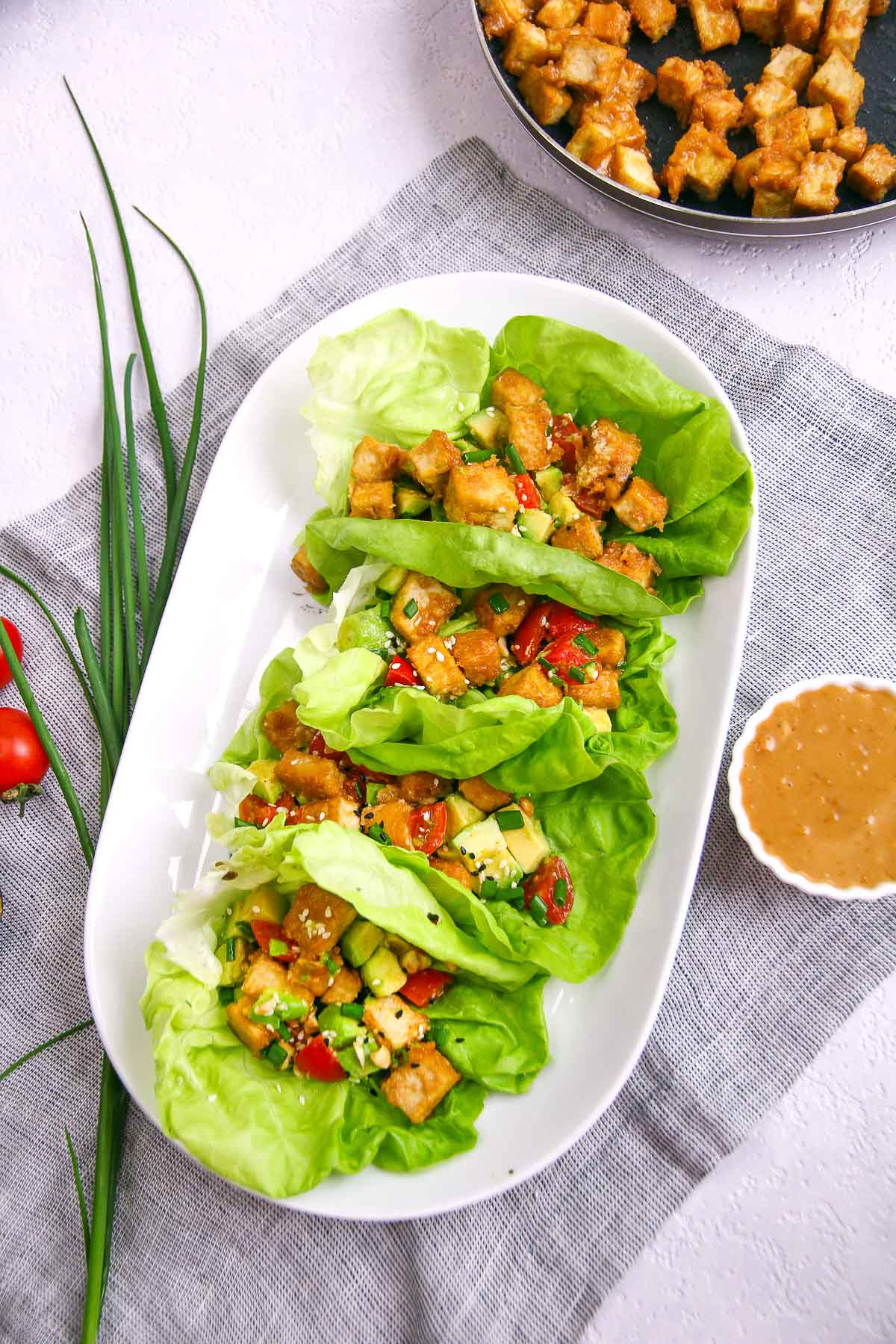 Healthy low carb and vegan tofu lettuce wraps appetizer recipe with peanut sauce.