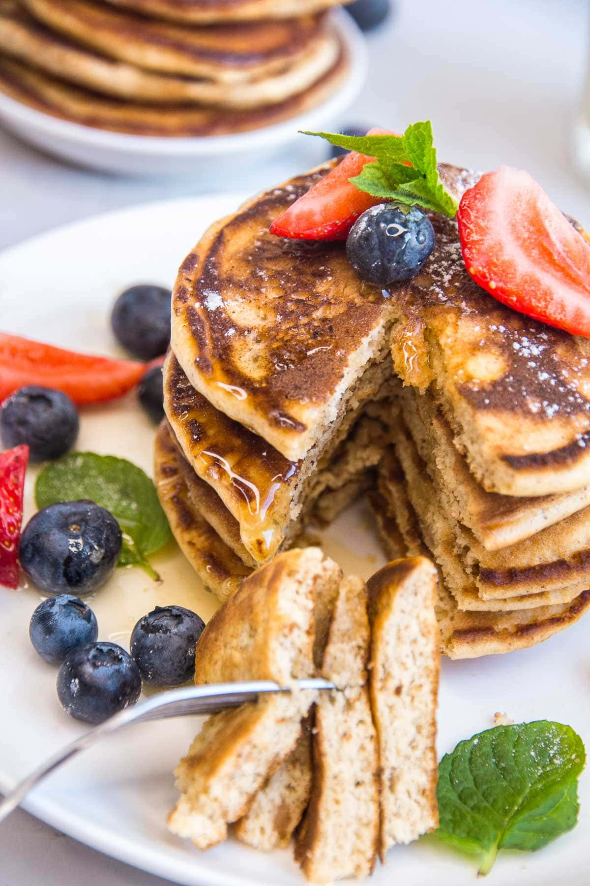 A slice of keto almond flour pancakes and fresh berries.